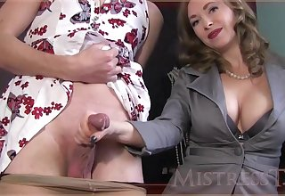 Experienced piece of baggage is giving a gentle handjob to a pretty guy, before of the camera