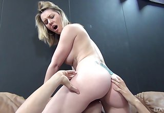 Fucking on the leather sofa with cum loving blonde Sierra Day
