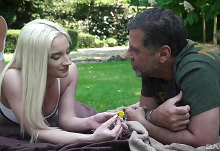 Out in the park, on guard blonde Angela Vital makes an older guy's day
