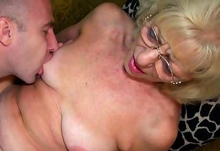 Blonde horny granny gets laid with young stud