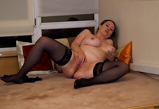 Horny mature wife Anastasiya spreads the brush legs and fingers the brush cunt