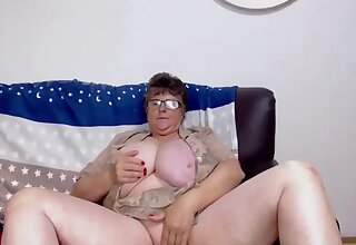 Erotic Grandma With Glasses Plays With Her Huge Tits