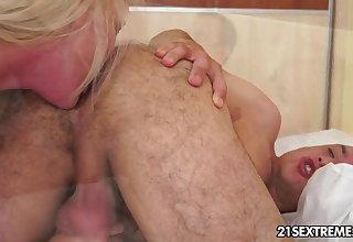Busty grandma Monik takes young cock