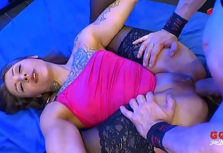 Tattooed whore in black stockings takes cocks in her ass