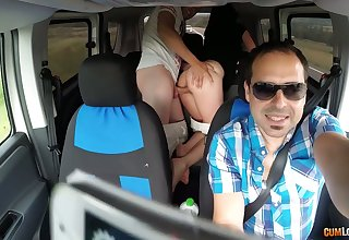 Kinky couple are having crazy quickie in the back seat in the presence of driver
