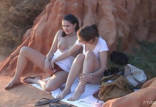 Exclusive pussy action at dusk for two teen babes