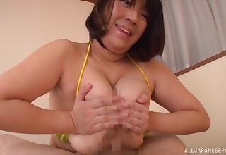 Big ass Asian mom shakes tits on a beamy learn of then fucks