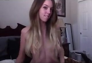 Coy girlfriend fucking herself with a dildo to orgasm