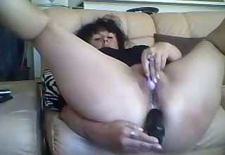That raunchy French slut isn't ashamed of gender her ass with her dildo on cam