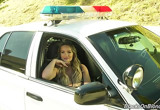 Sitting in cop's car abnormal porn actress Cali Carter holds interview