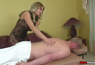 Stern blonde wraps rope almost a cock during Femdom handjob